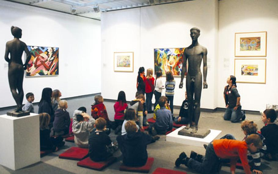 Schoolchildren learn about 20th-century art at the Germanisches National Museum in Nuremberg, Germany.