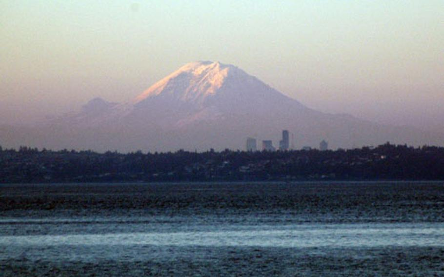 A view of Mount Rainier rising up over Puget Sound at dawn, from the Edmonds-Kingston ferry.