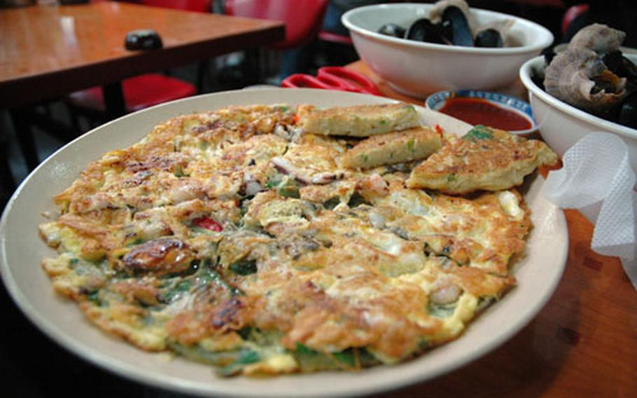 Seafood jeon is one of the more traditional types of pancake. Most Americans order fish or sesame leaf jeon, while Japanese tourists prefer ones with oysters. Koreans like mungbean, which fries up light and spongy, almost like a hash brown.