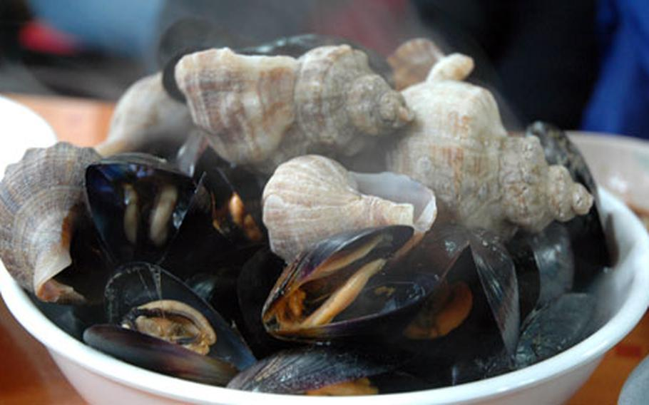 The restaurant has other dishes as well, including these steamed mussels and conches, which cost 6,000 won.
