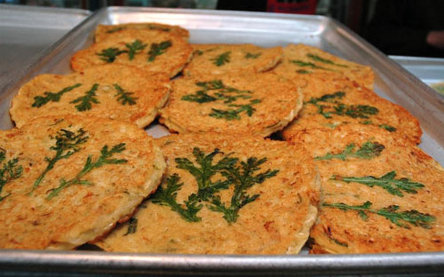 This is jeon: a savory pancake usually filled with onion, kimchi, mung bean or seafood. The restaurant Mapo Halmae Bindaeed Tteok in Seoul has become a destination for jeon and other fried foods. The eatery opened 30 years ago as a stall; now it's grown into a collection of rooms and counters all dedicated to frying.