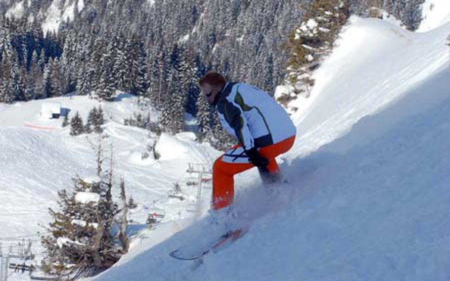Tannenbaum Ski Club member Jeff Cowan takes on a slope at Avoriaz, on the French side of the Portes du Soleil ski area, on his snowboard on President's Day Weekend.
