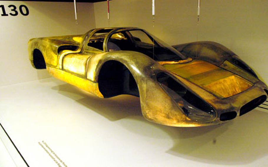 Built for speed, this lightweight fiberglass frame for the Porsche 908 weighs just 130 kilograms — less than 300 pounds. The Porsche museum features engines and other pieces of technology that illustrate how the cars are built for speed.