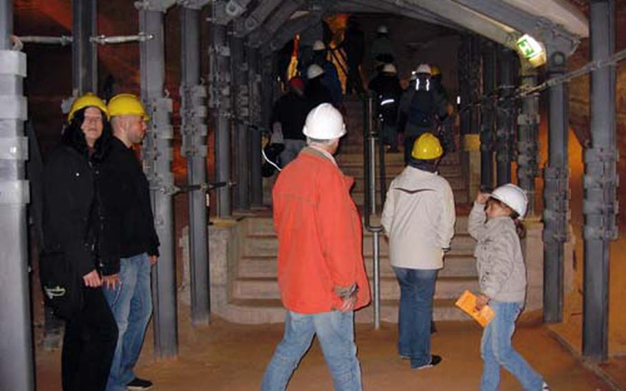 Hard hats and guided tours are mandatory during a visit to the Schlossberg Caves.
