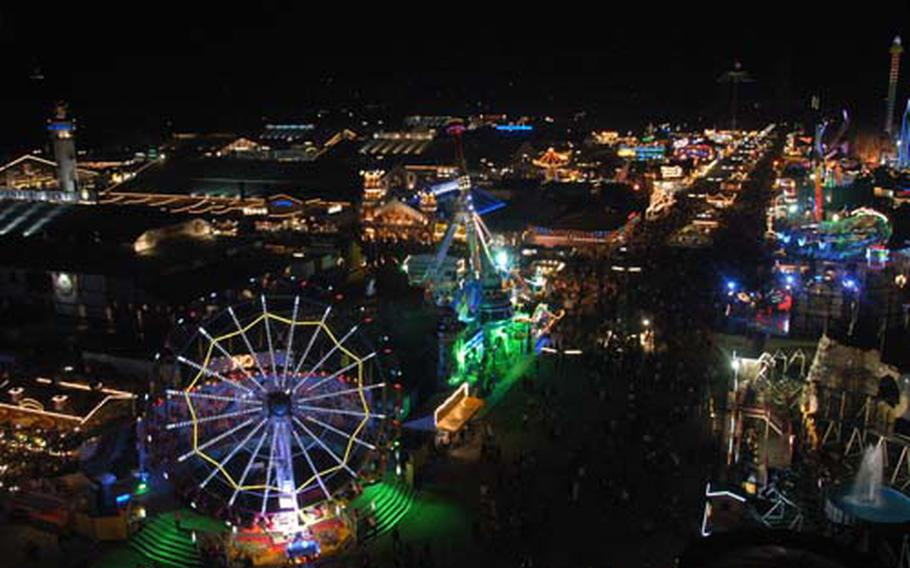The festival grounds sparkle at night in this view from atop the Ferris wheel. More than 6 million people are expected to take part in the festival by closing time Sunday.