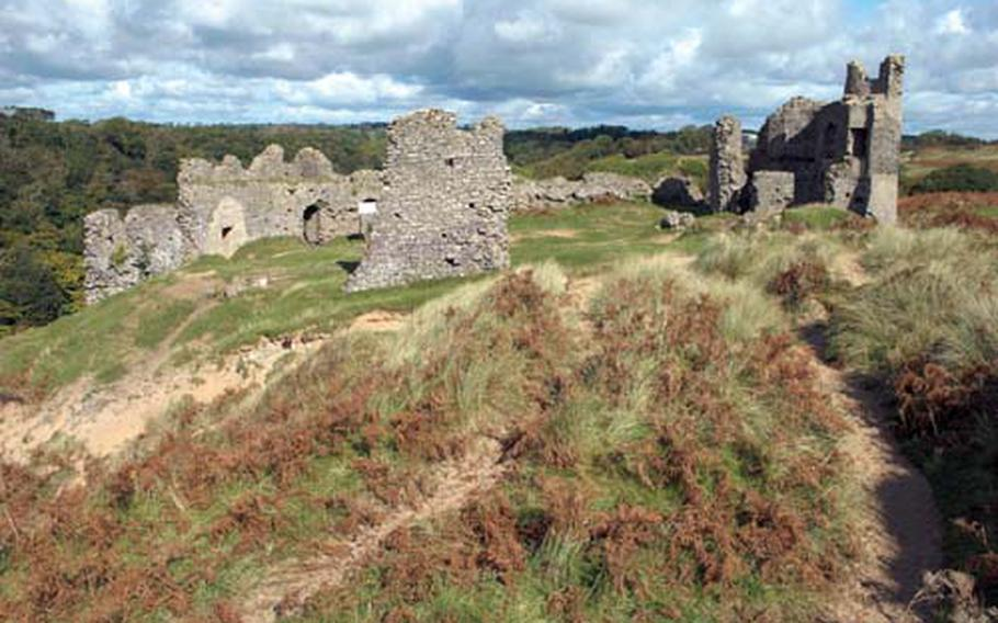 Some 12th-century ruins of Pennard Castle beside the Pennard Golf Club.