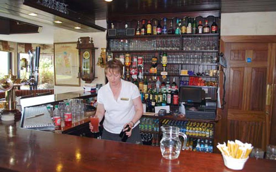 The bar at Dooks Golf Club, Ireland, offers a cozy ambience.
