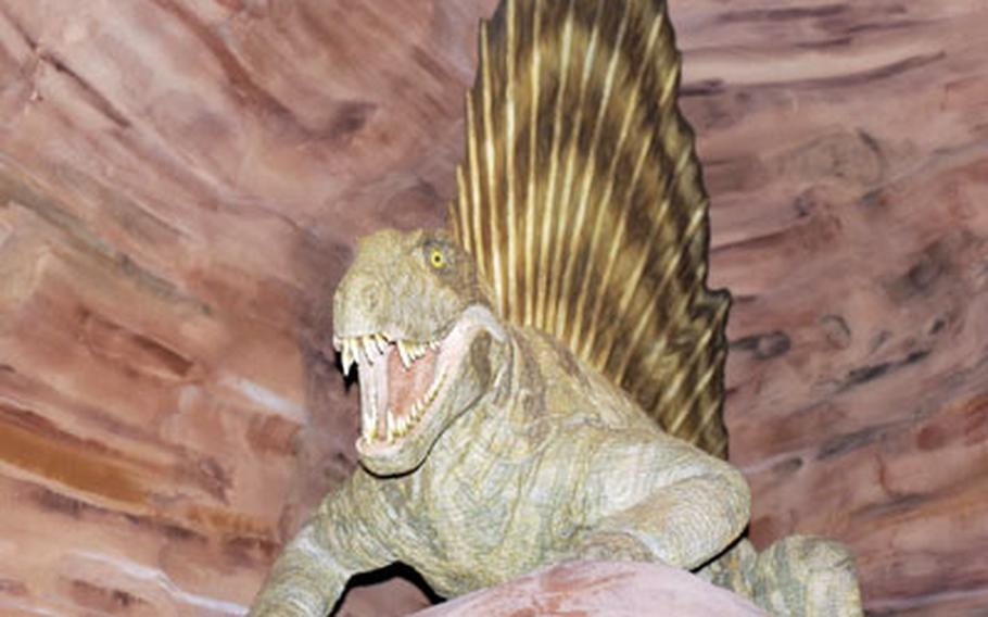 A robotic prehistoric predator in the Das Praehistorium's Permian gorge growls and shows its teeth as it greets visitors. The museum in Schiffweiler, Germany, gives visitors a history lesson on the prehistoric world.