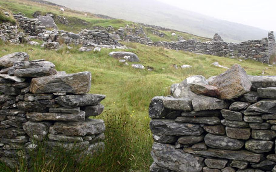 Ireland's Deserted Village on Achill island is the site of an archaeological site called Deserted Village, with ruins of homes left by victims of the Great Irish Potato Famine. The ruins remain as a monument to those who died.