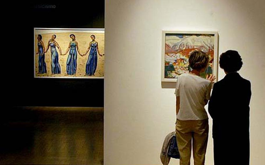 """Visitors check out a painting by Giovanni Giacometti during a recent visit to the Museum of Modern and Contemporary Art of Trento and Rovereto. The art gallery is currently featuring """"Masterpieces of Modernity,"""" a collection of works by famous — and not-so-famous — artists on loan from the Kunstmuseum Winterthur of Switzerland."""