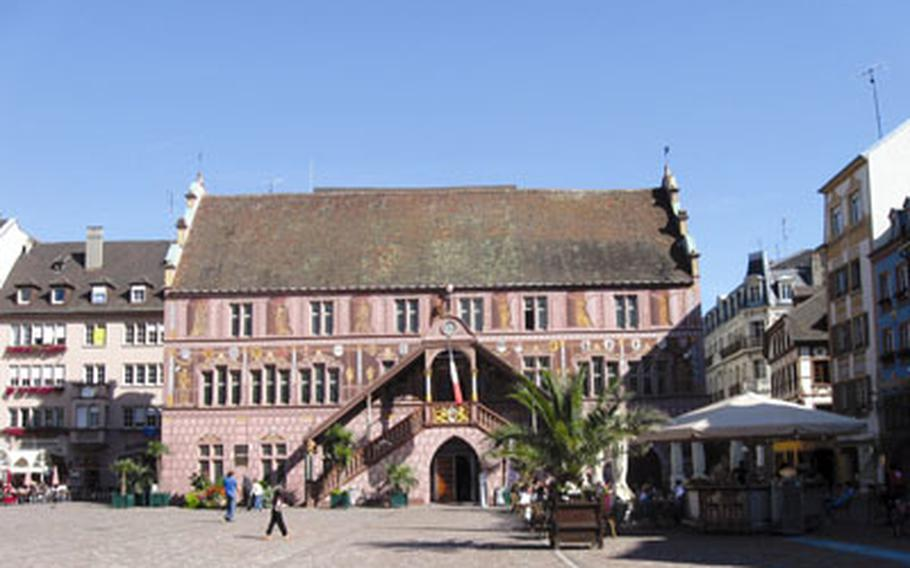 The town hall for Mulhouse, France, was built in 1552 and is unusual for France. Its exterior is painted to give the impression of pillars, balcony railings and statues. It sits on one end of the Place de la Reunion in the pedestrian zone.