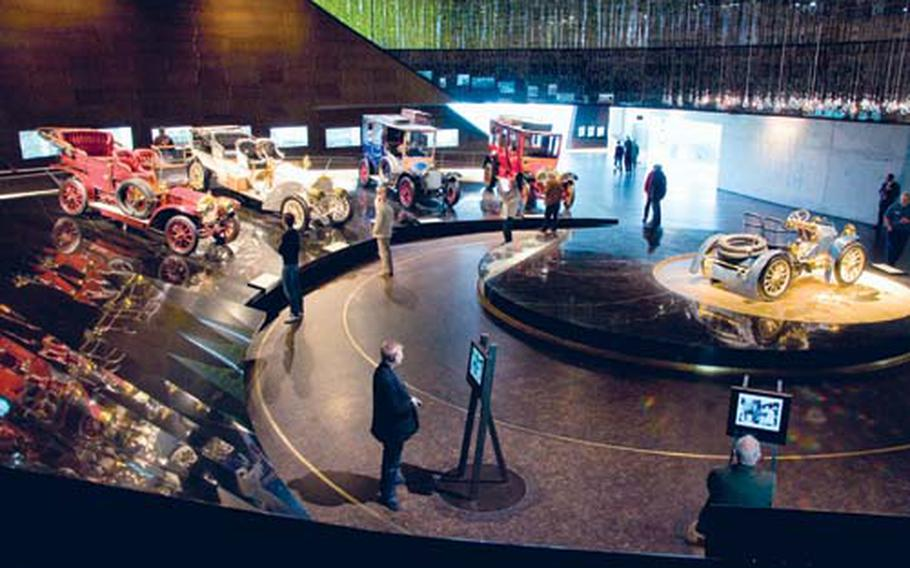 """The """"Birth of a Brand"""" exhibit in the Mercedes-Benz Museum features automobiles from the beginning of the company's efforts in modern automobiles. The exhibit showcases what the museum calls the first modern automobile, the 35 HP Mercedes."""