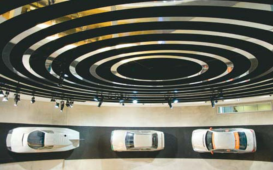 Near the end of the museum tour, viewers can see concept cars lining the walls of the final staircase.