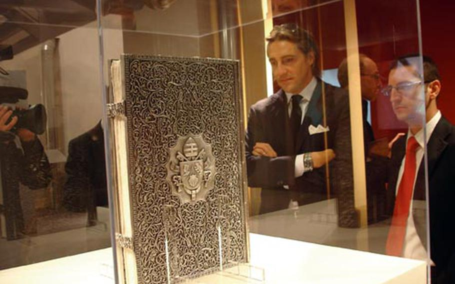A book made of hand-carved silver contains Pope Benedict XVI's first encyclical — hand-printed and illustrated with vegetable dyes and gold leaf. The piece is part of the exhibit honoring Caterina de' Medici at Complesso del Vittoriano in Rome.