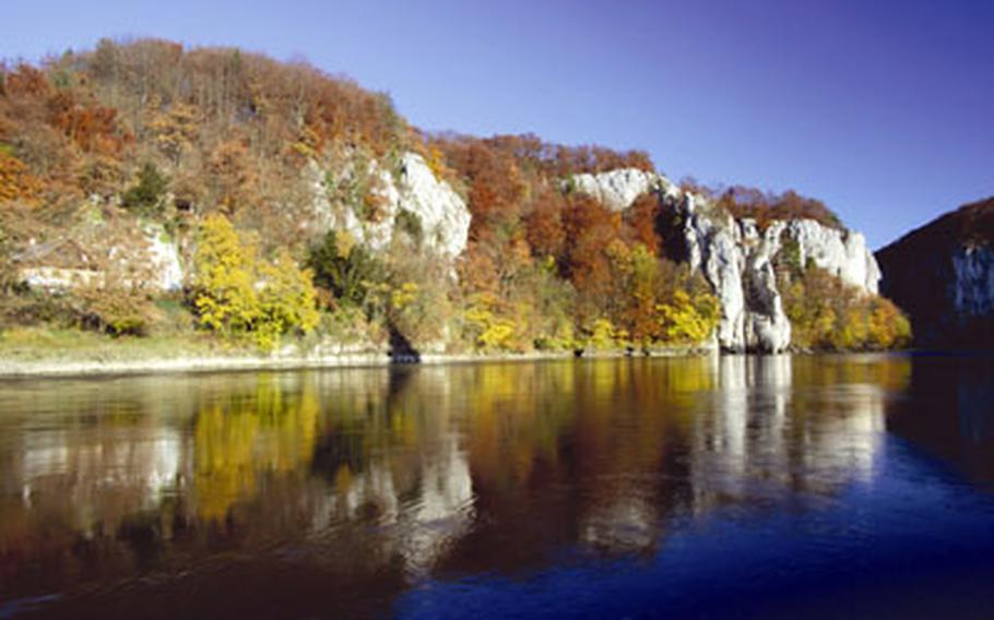 The cliffs along the Danube Gorge near Weltenburg Abbey are particularly dramatic in the fall when red and yellow leaves stand out against the white rock.