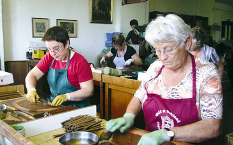 Seven women are employed making handmade cigars at Wolf und Ruhland in Perlesreut, Germany.