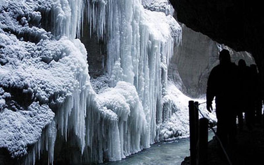 Hikers walk past huge icicles in the Partnachklamm canyon near Garmisch-Partenkirchen, southern Germany.