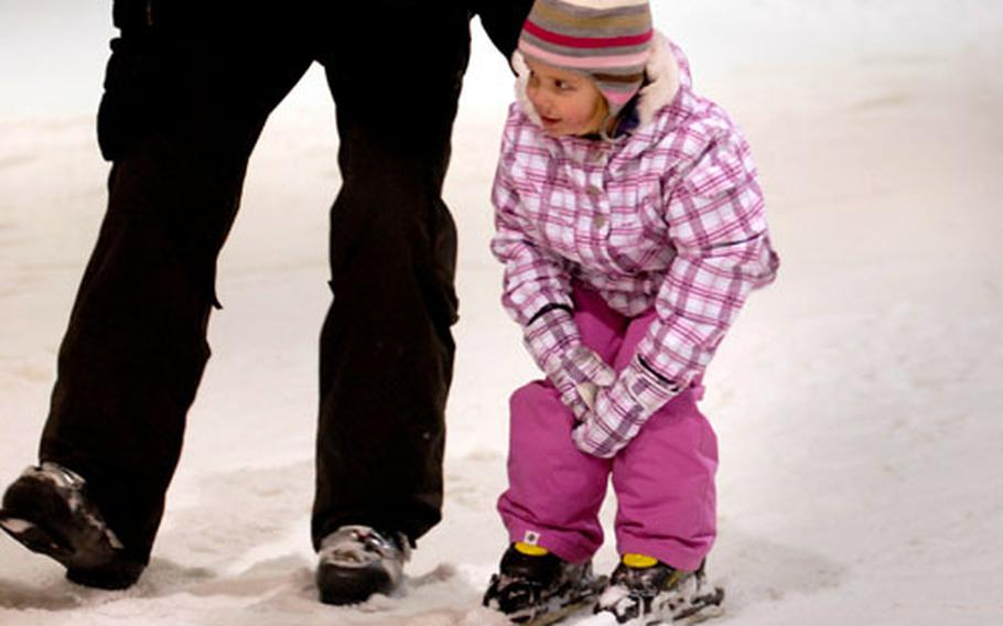 A young skier gets a helping hand and a gentle push from dad at Snow Valley.