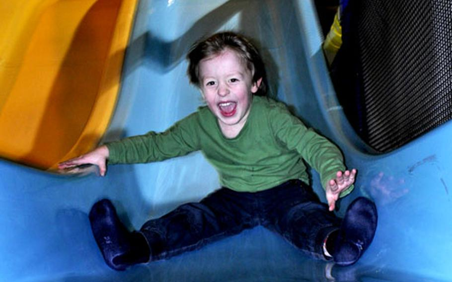 Four-year-old Linus enjoys a ride on one of the many slides at Tucherland.