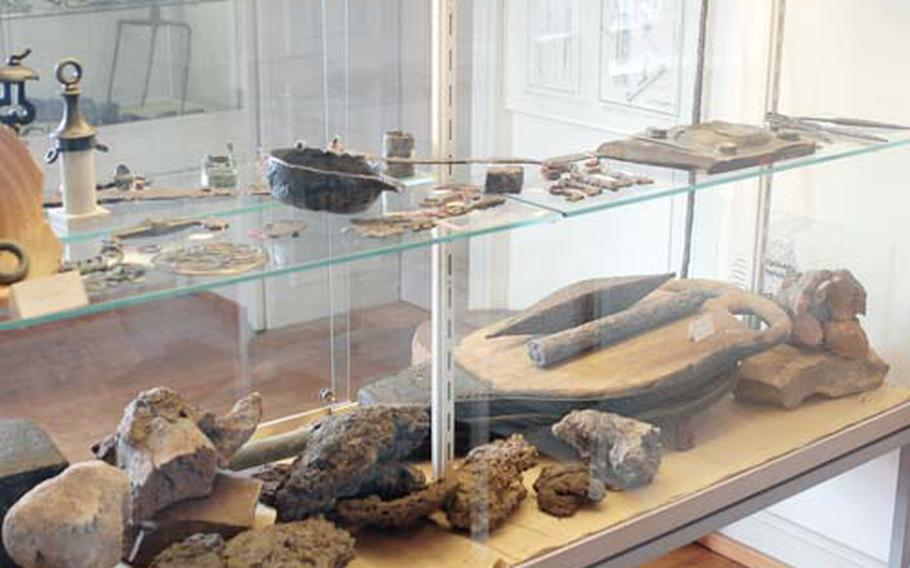 The museum's artifact collection includes tools, keys and other items unearthed in the nearby ruins. The three-story museum also includes 18th-century art as well as a video that shows what life was like in the village before it was destroyed.