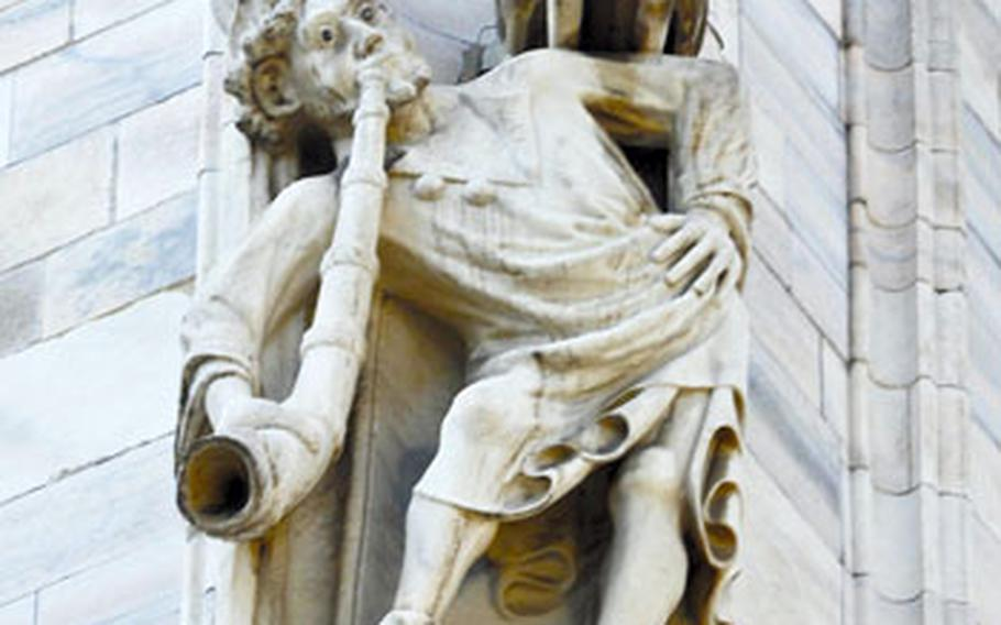 Hundreds of statues decorate the exterior of Milan's cathedral. Many depict biblical or religious figures.