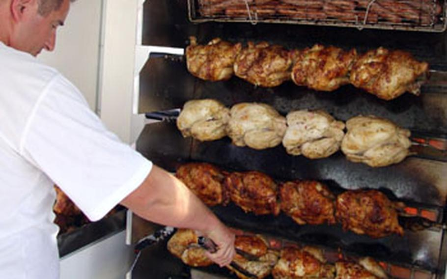 Grilled chickens smell so good that many shoppers will take one home for an after-market lunch.