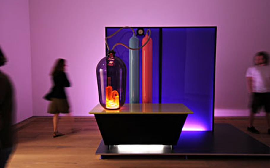 """""""Kandor 15"""" is the title of a science-fiction, dreamlike installation created by Mike Kelley with wood, Plexiglas, aluminum, glass, fluorescent lights and audio equipment."""