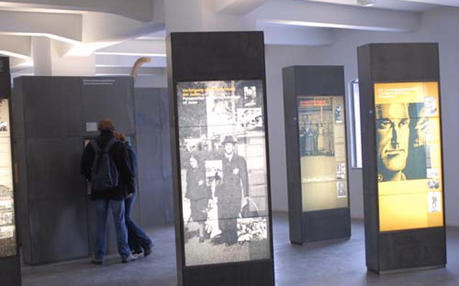 The depot building was once used to store the belongings of the prisoners at the Buchenwald concentration camp. Now it is an exhibit hall with artifacts from the camp and information about the Holocaust. It includes information about the number of people killed in Nazi death camps.