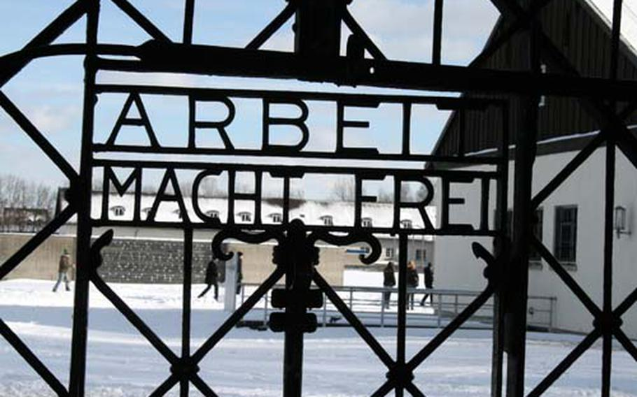 """The front gate to Dachau includes the infamous slogan that translates to """"Work makes you free."""" The more-famous """"Arbeit Macht Frei"""" sign at the former Auschwitz concentration camp in Poland was stolen in December, but recovered two days later."""