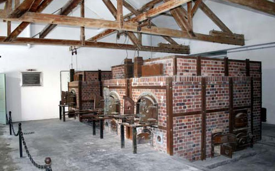 The ovens inside the new crematorium at Dachau, built because the existing crematorium could not keep up with the volume. The support beams overhead were also used to hang prisoners. The oven rooms were next to the gas chambers; it was a building designed to manufacture death.