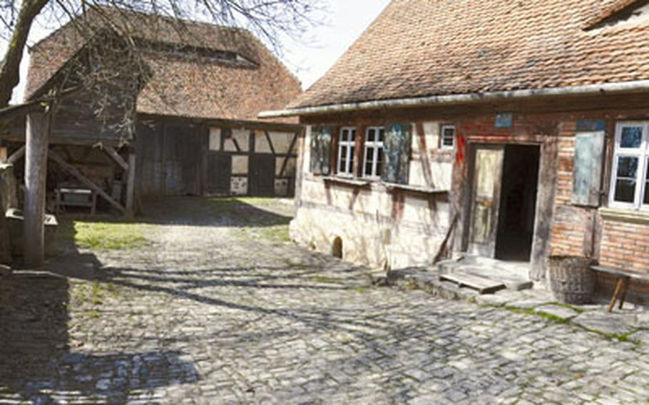 This reconstructed farmstead includes a farmhouse and stable, smithy, pigsty, shed and barn and dates back to 1749.