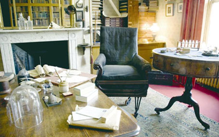 """Charles Darwin's study features many of his personal items and scientific instruments. In the background is a chair where Darwin may have sat when he wrote """"On the Origin of Species."""""""