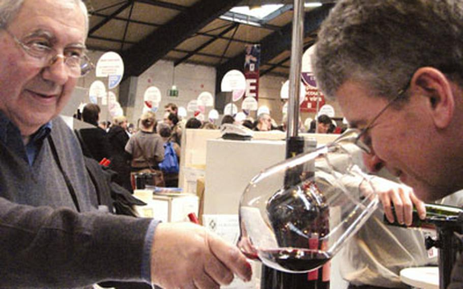 A patron inhales the bouquet of a Chateau Bouchat-Alaux wine, an important step in the wine-tasting process.