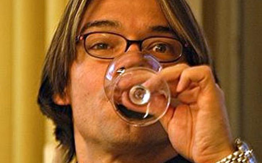 """Christian Mappala, 43, German wine expert and leader of the wine sensory seminars takes a """"nose full"""" of wine."""