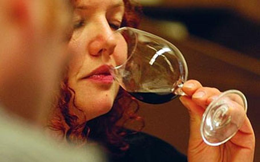 After examining the color, the second step in judging wine is to smell the aroma.