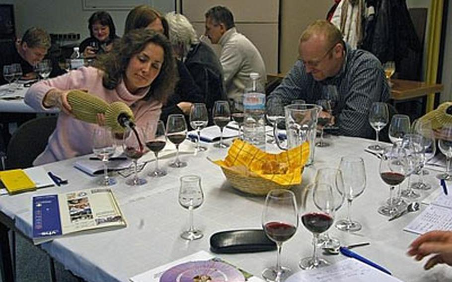 Blind probe. Students test three different red wines, determining whether they are dry, acidic, light or strong.