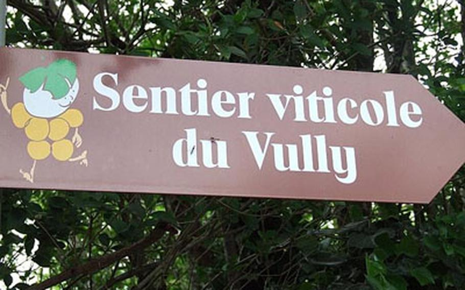 A sign shows the way to the wine trail through the Vully vineyards.