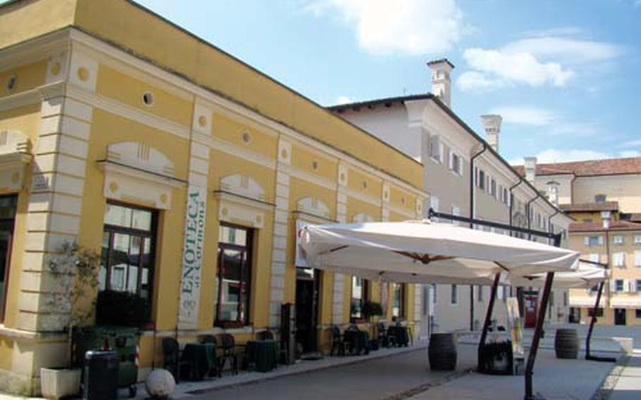 The Enoteca of Cormons is in the center of the village of Cormons. Barrels set up underneath large umbrellas outside the regional wine shop double as tables where you can enjoy a glass of wine purchased inside. The enoteca sells and promotes wine from 33 local winemakers.