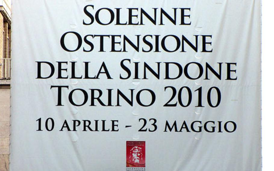 """A banner that reads """"Solemn Exhibition of the Shroud, Turin 2010, 10 April-23 May"""" hangs over the street at the end of Piazza San Carlo, one of the main squares in Turin, Italy. The city has rolled out the red carpet for the expected two million visitors for this year's exhibition."""