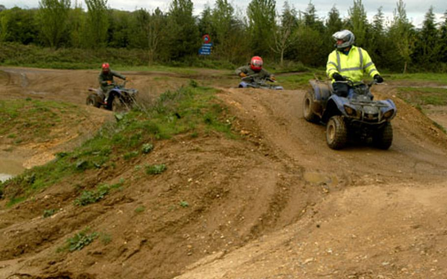 An instructor at the WildTracks outdoor center leads a group of youngsters around the 4-by-4, off-road track on all-terrain vehicles.