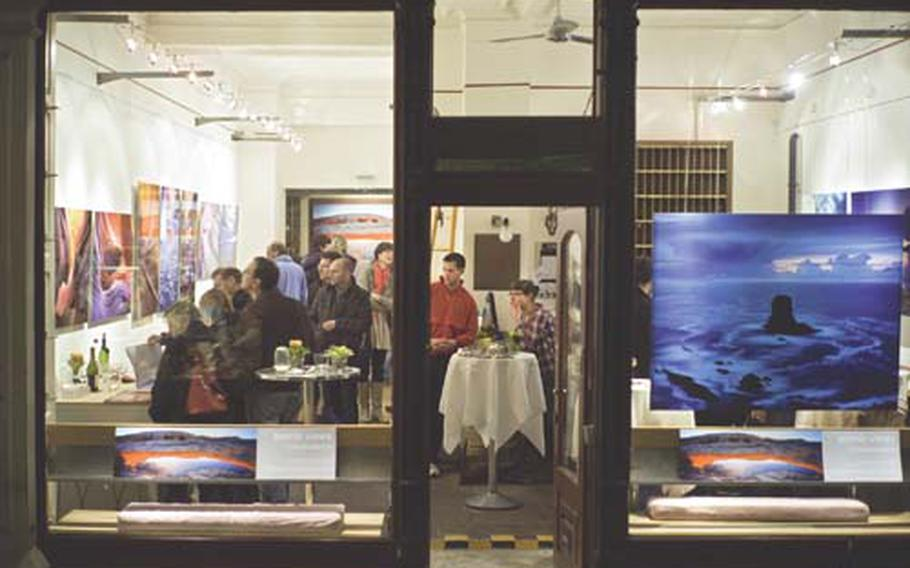 Alexander Ehhalt's gallery is filled with his large color photographs of nature and a crowd of viewers during Heidelberg's Long Night of Museums.