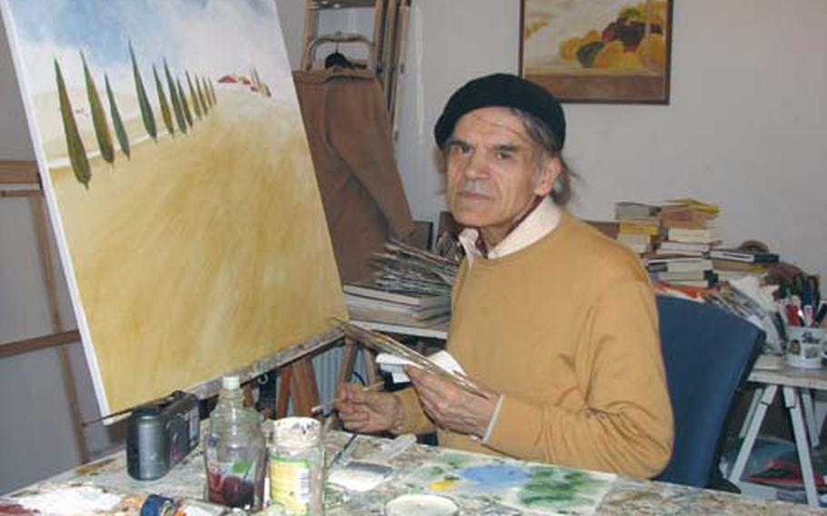 """Artist Wassili Lepanto, whose work has been exhibited in New York, Paris and Athens, prepares to work on one of his """"ecological"""" landscapes. He discussed the theory behind his paintings during Heidelberg's museum night."""