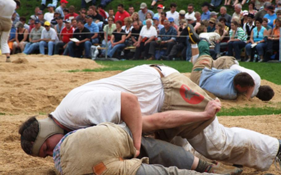 """""""Schwingen"""" wrestlers hang onto their opponent's shorts as they try to pin their foe's shoulder to the ground in a large sawdust-covered pit. Wrestlers get points for throws and for pinning their opponents."""