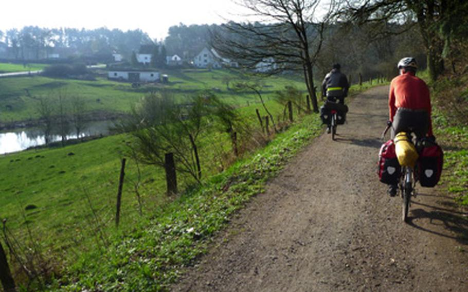 This stretch of the  Glan-Blies-Weg is wide and flat and goes through beautiful scenery. Luke Stover, right, and Nick Schulte ride in the early morning near Schönenberg-Kübelberg in Germany on an overnight trip in the spring retracing part of the bike trip to France.