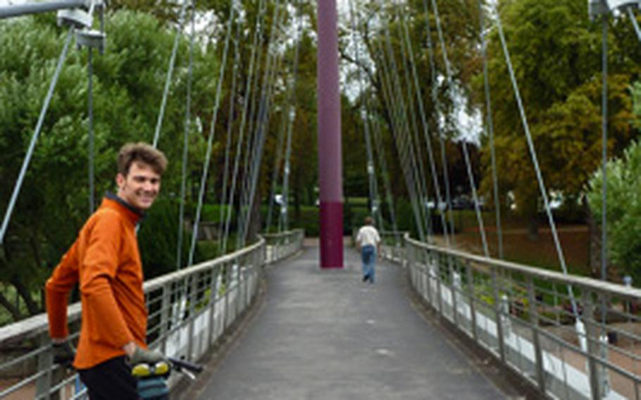 Reporter Ben Bloker poses for a photo on a bridge in Sarreguemines, France, during the first day of an overnight bike tour.