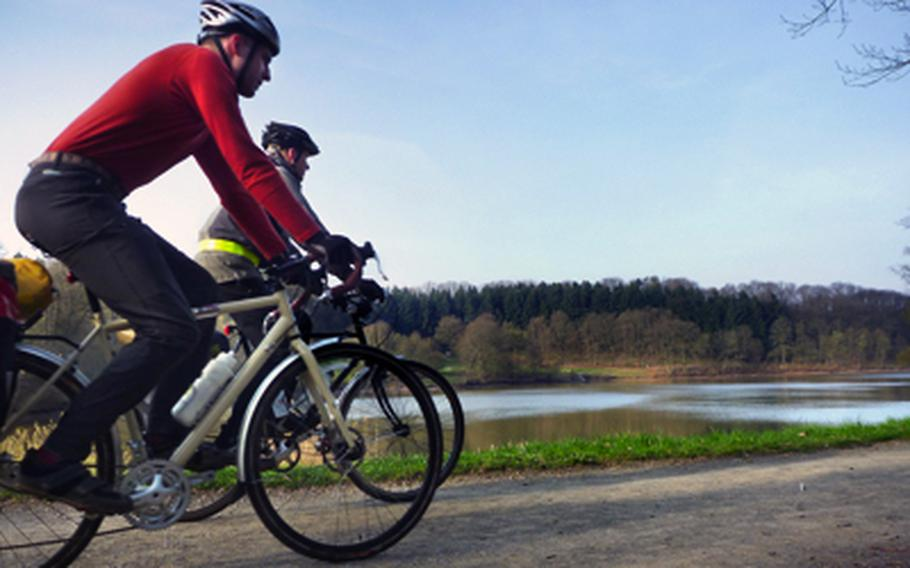 Luke Stover, left, and Nick Schulte ride along the reservoir near Schönenberg-Kübelberg on the return leg of an overnight bike-camping trip in the spring that retraced part of a two-day round trip to France in the summer.