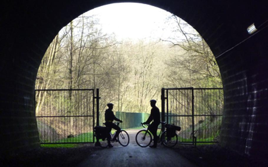 Cyclists take a break in a tunnel on the Glan-Blies-Weg, a cycling and hiking path in western Germany that was used during a repeat cycling trip from Ramstein Air Base, Germany, to  Sarreguemines, France.