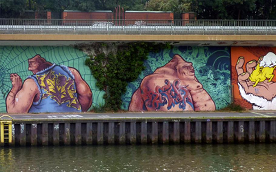 Detailed graffiti murals along the Saar River in Saarbrücken, Germany, make for interesting viewing on the way to France.