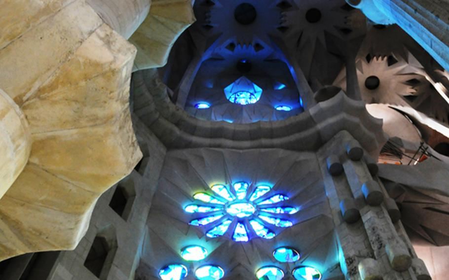 Antoni Gaudi was impassioned by glass, light and incredibly high ceilings. Quoting  a placard of his thoughts in La Sagrada Familia church, still unfinished to this day: The highest large windows, those in the main nave, will be of plain glass, because their purpose is to illuminate the vaults which are decorated with mosaics.