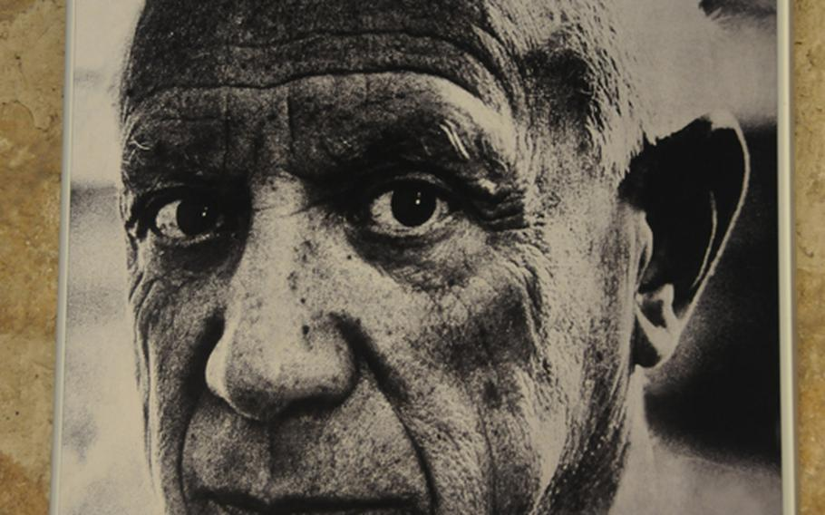 A photograph of Pablo Picasso that hangs in the Picasso Museum in Barcelona. It is dedicated to the formative years of the famed artist and houses 3,800 works in its permanent collection.